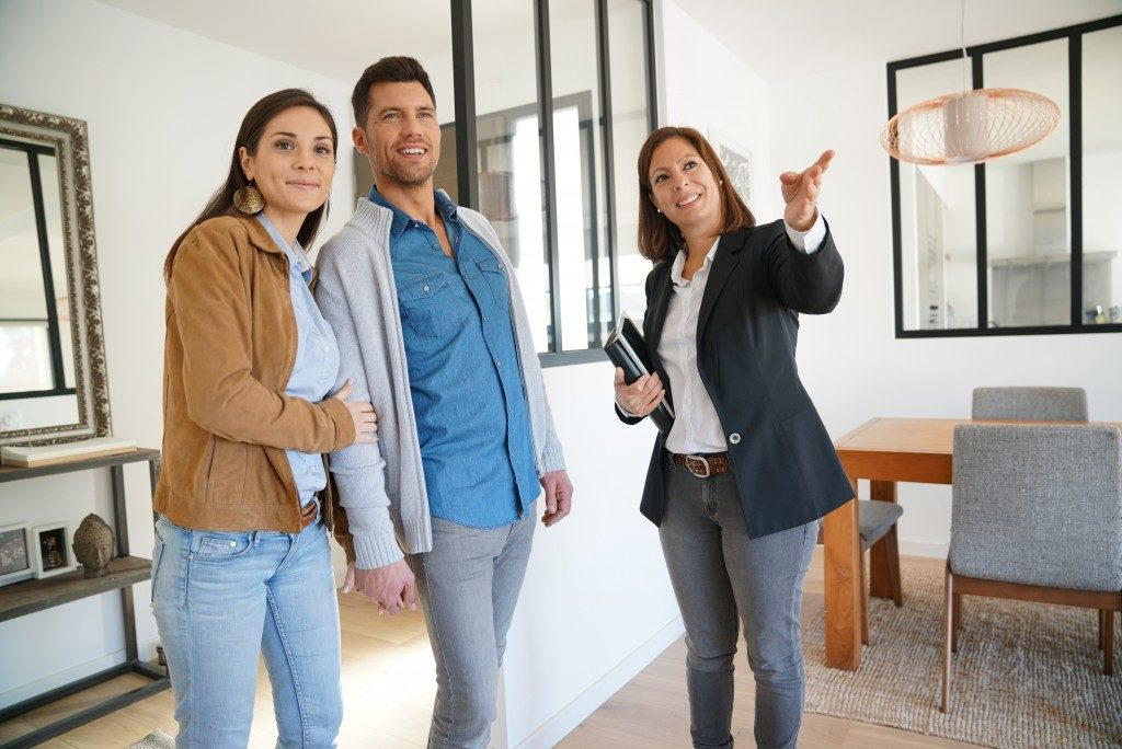 realtor showing the couple a house