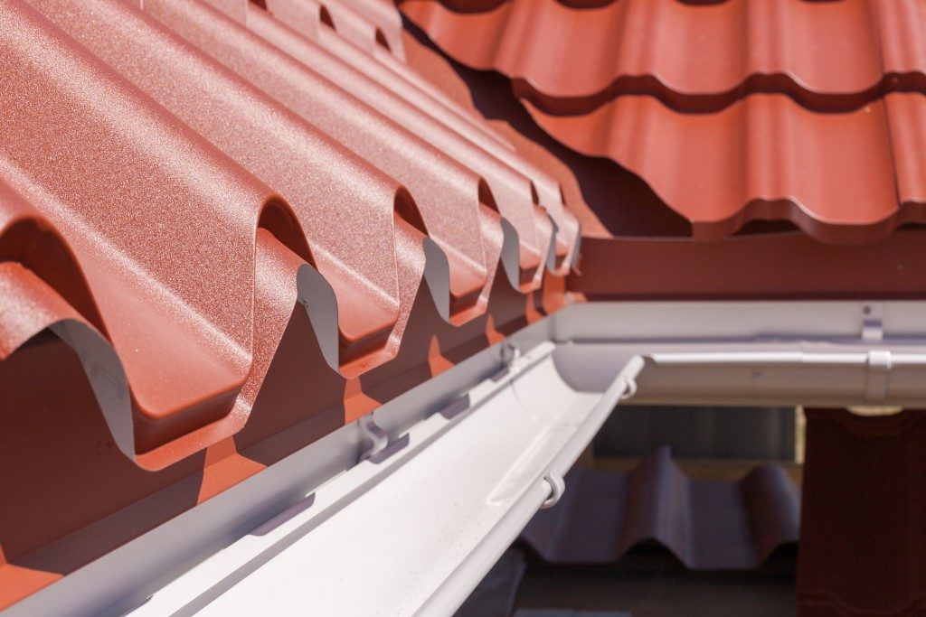 red metal tile with white rain gutter