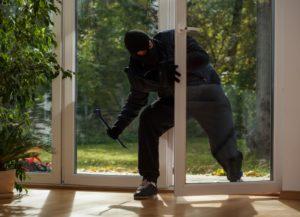 man robbing a house