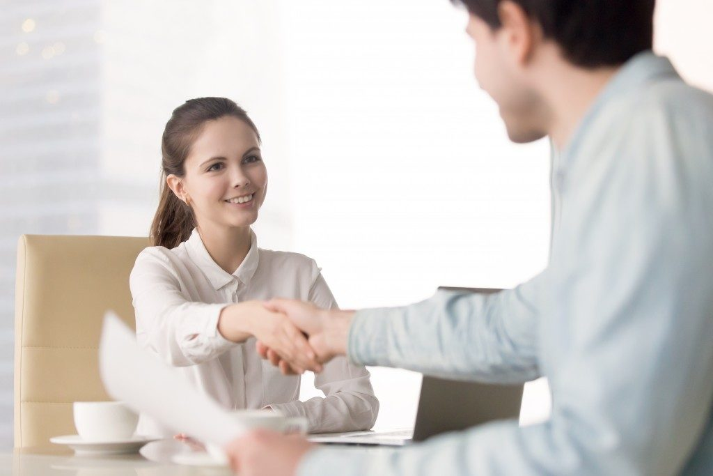 applicant shaking hands with her interviewer