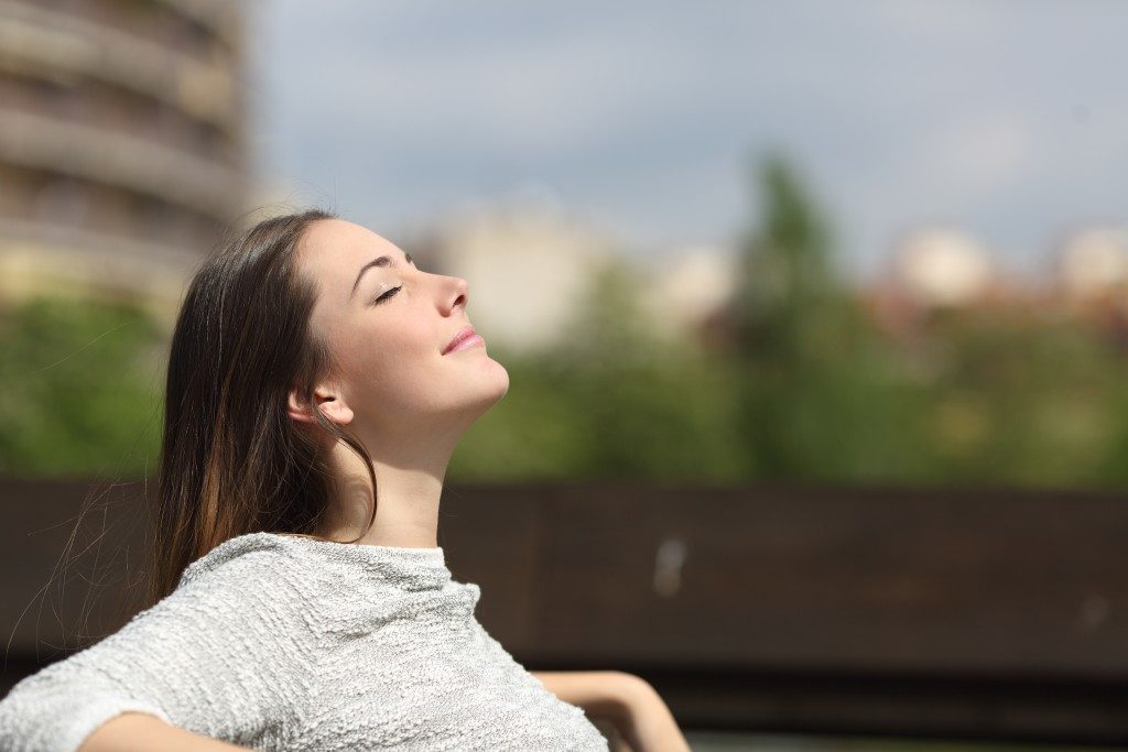 woman relaxing on a bench