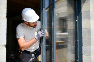 Man fixing window
