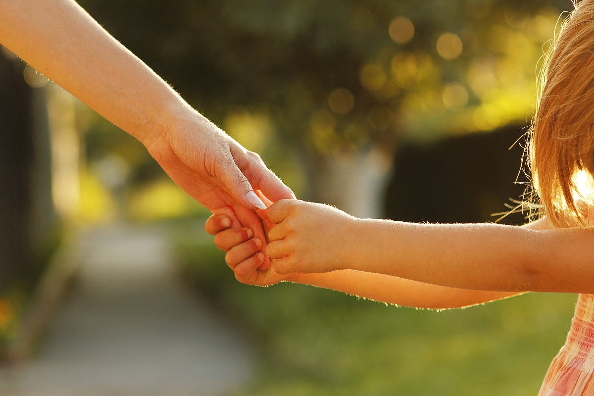 child holding hand of parent