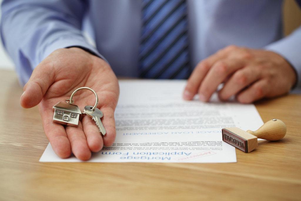 broker handing a house key