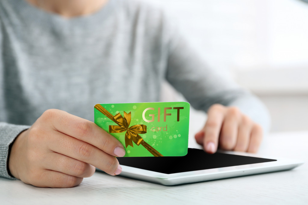 person holding a gift card
