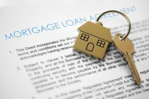 house keys and mortgage contract