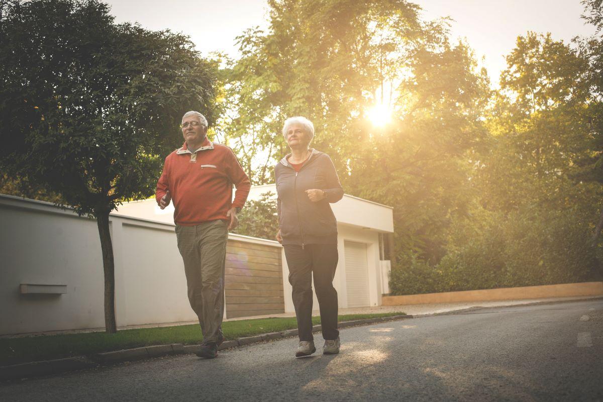 senior citizen couple jogging