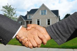 shaking hands over purchase of house