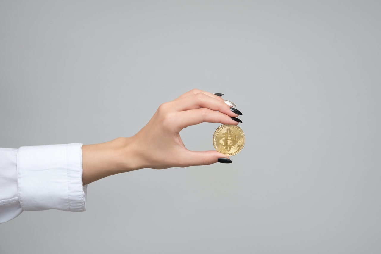 person holding a gold coin