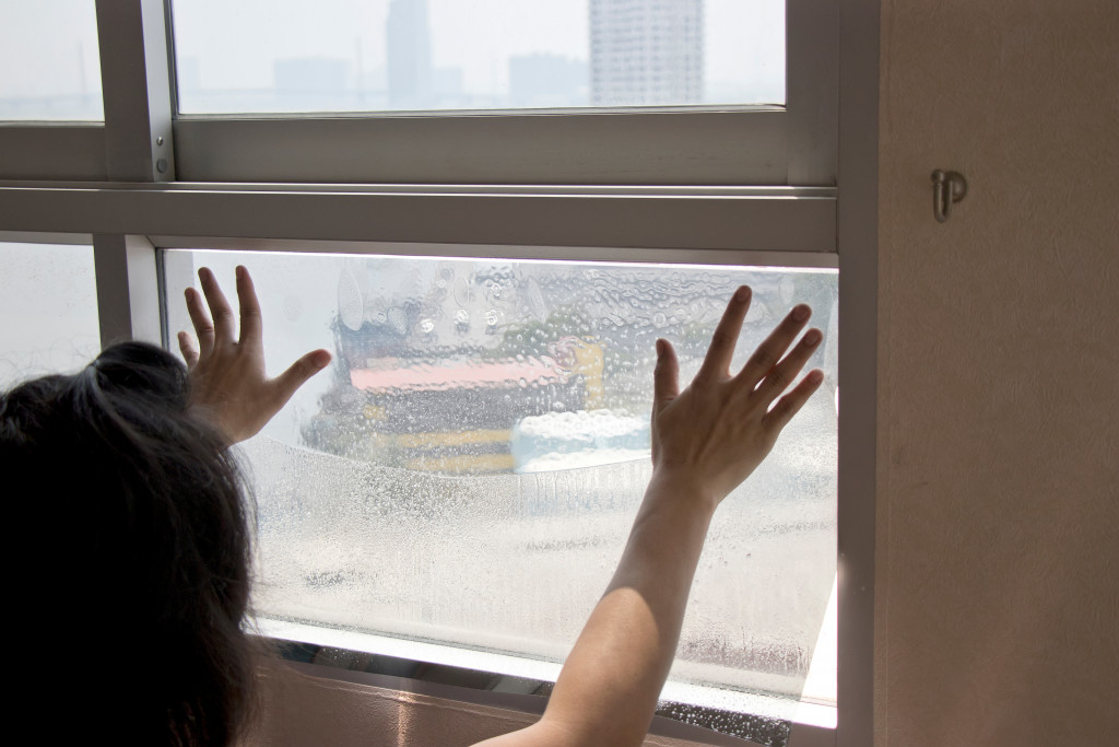 woman checking the windows