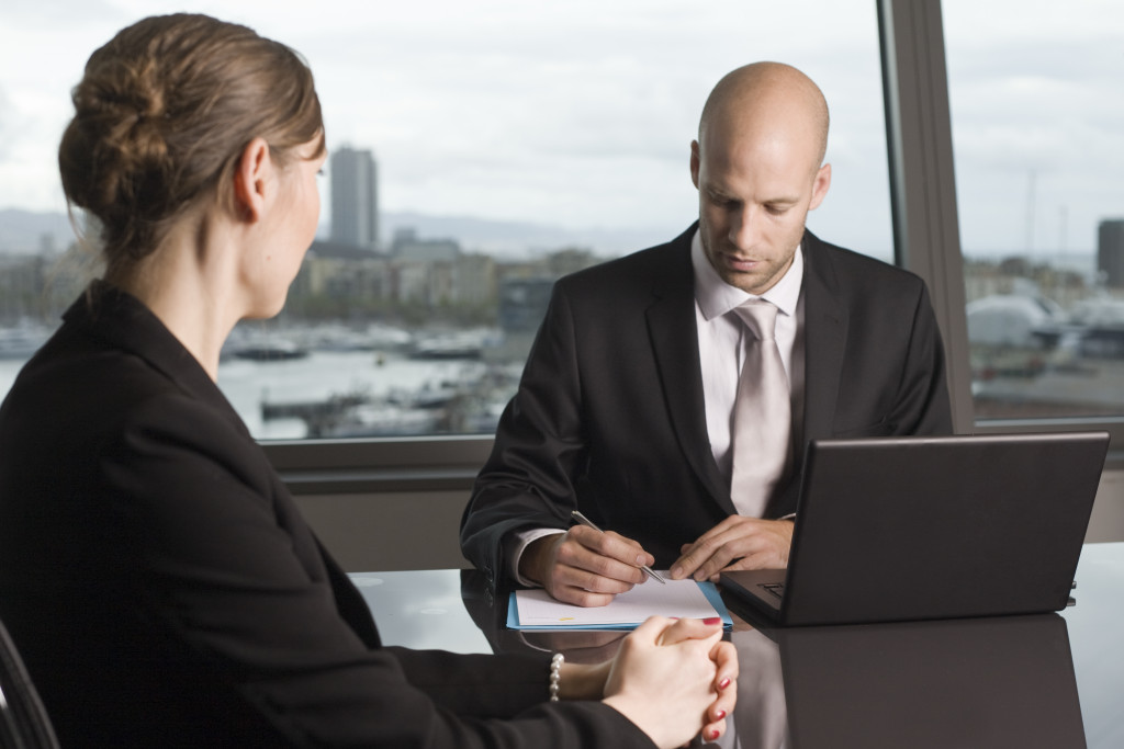 woman settling financials with her lawyer