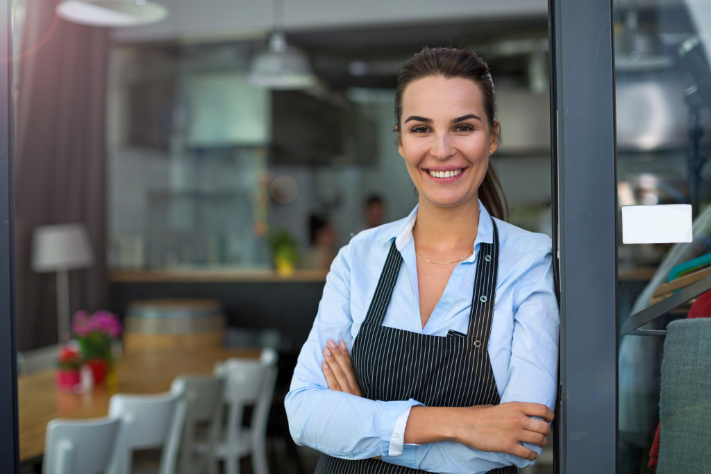 waitress standing in front of resturant