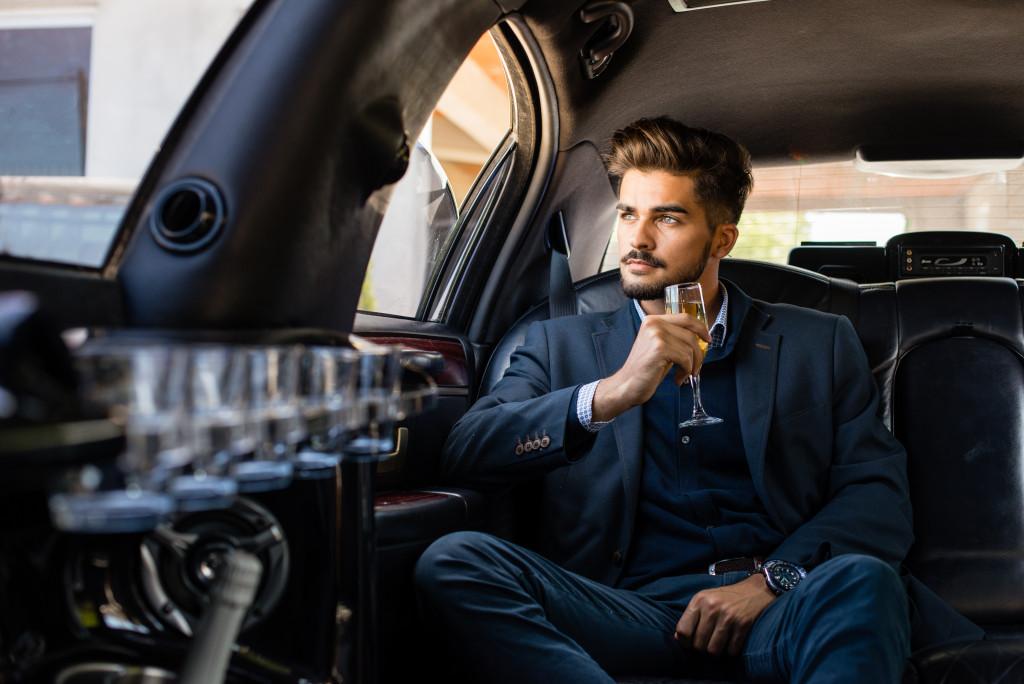 man in a luxury car